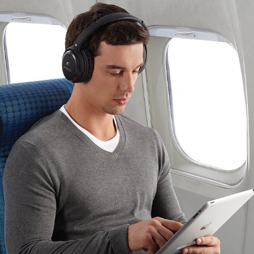 able-planet-headphones-man-in-airplane